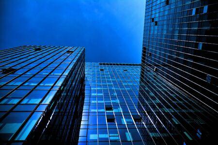Black glass silhouette of skyscraper at night Stock Photo