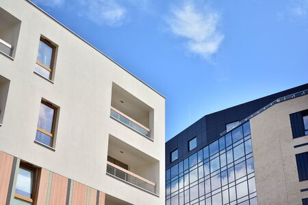 Modern multi-storey luxury housing concept. Modern apartment building with blue sky and clouds.