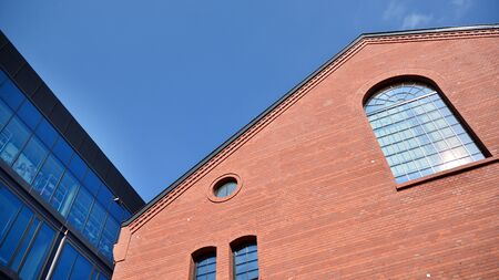 Revitalized red brick building and modern office building.
