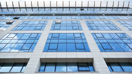 Panoramic and perspective wide angle view to steel light blue background of glass office building commercial modern city of future. Business concept of success industry tech architecture. Stock Photo