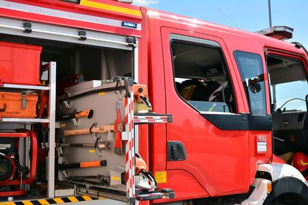 Warsaw, Poland. 24 August 2019. Fire engine equipment Renault Trucks. Fire hoses and other equipment in a truck to be used by firefighters. Banque d'images - 130076777