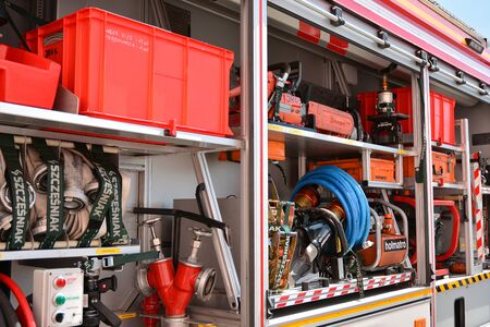 Warsaw, Poland. 24 August 2019. Fire engine equipment Renault Trucks. Fire hoses and other equipment in a truck to be used by firefighters. Banque d'images - 130076782