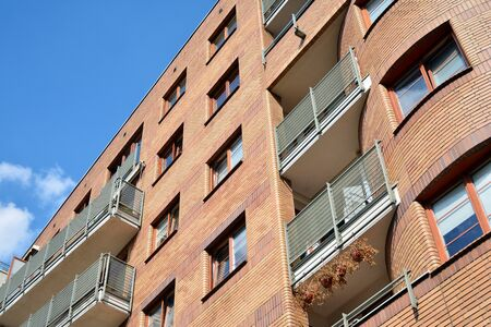 Modern apartment buildings on a sunny day with a blue sky. Facade of a modern apartment building Фото со стока