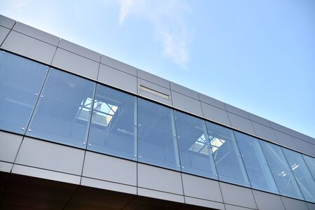 The windows of a modern building for offices. Business buildings architecture.