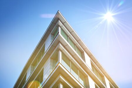 Modern office building detail, glass surface with sunlight Stock Photo