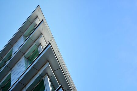 Facade fragment of a modern office building. Exterior of glass wall with abstract texture. Stok Fotoğraf
