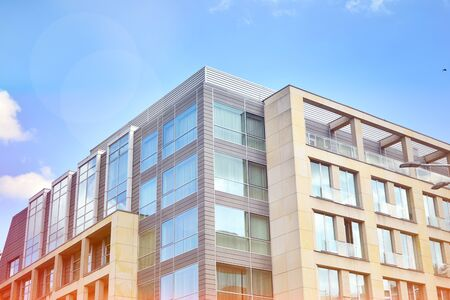 Modern office building detail, glass surface with sunlight Imagens