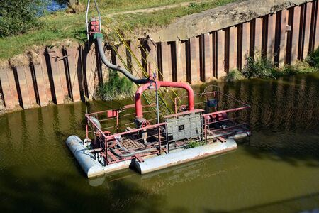 River pump station on floating mooring for water pumping.