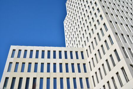 Modern office building detail. Perspective view of geometric angular concrete windows on the facade of a modernist brutalist style building. Foto de archivo