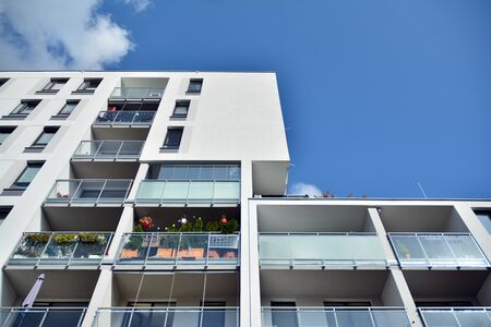 Modern luxury urban apartment building exterior with blue sky Stock Photo