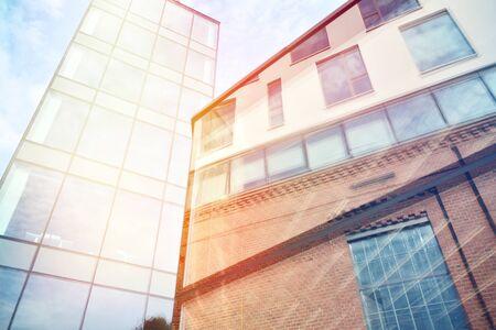 Modern office building detail, glass surface with sunlight 免版税图像