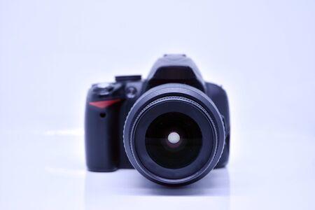 Digital photo camera isolated on bright background