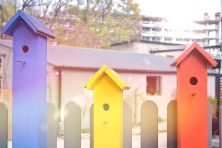 Collection of colorful wooden birdhouses. Reklamní fotografie