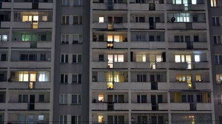 Exterior of apartment building at night with light from windows
