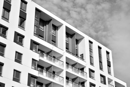 Contemporary apartment building. Generic residential architecture. Black and white.