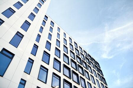 Modern European building. White building with many windows against the blue sky. Abstract architecture, fragment of modern urban geometry. Stock fotó - 133966814