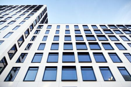 Modern European building. White building with many windows against the blue sky. Abstract architecture, fragment of modern urban geometry. Stock fotó - 133966816