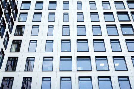 Modern European building. White building with many windows against the blue sky. Abstract architecture, fragment of modern urban geometry. Stock fotó - 133966825