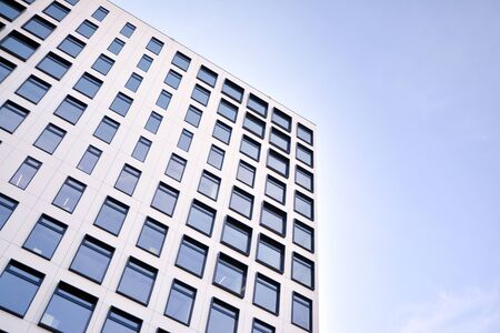 Modern European building. White building with many windows against the blue sky. Abstract architecture, fragment of modern urban geometry. Stock fotó - 133966827