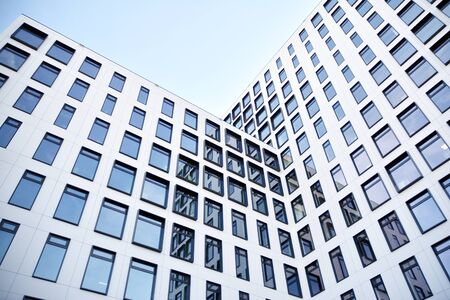 Modern European building. White building with many windows against the blue sky. Abstract architecture, fragment of modern urban geometry. Stock fotó - 133966828