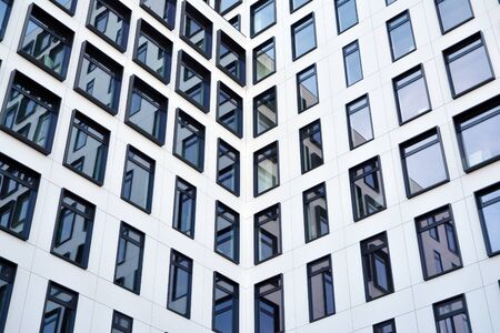 Modern European building. White building with many windows against the blue sky. Abstract architecture, fragment of modern urban geometry. Stock fotó - 133966829