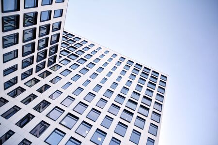 Modern European building. White building with many windows against the blue sky. Abstract architecture, fragment of modern urban geometry. Stock fotó - 133966832