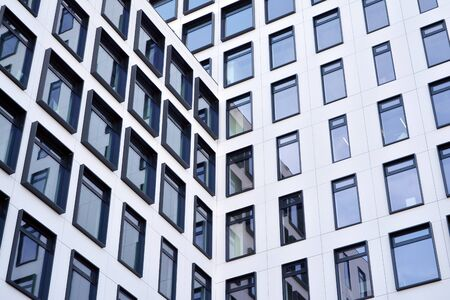 Modern European building. White building with many windows against the blue sky. Abstract architecture, fragment of modern urban geometry. Stock fotó - 133966849