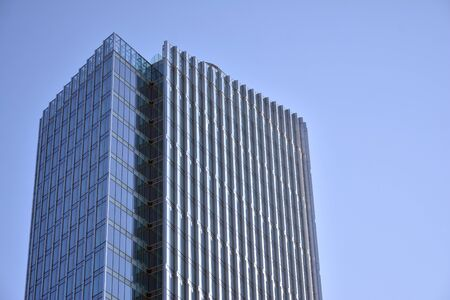 Modern office building wall made of steel and glass with blue sky Stock fotó - 133966862