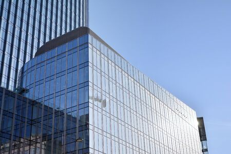 Modern office building wall made of steel and glass with blue sky Stock fotó - 133966836
