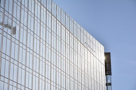 Modern office building wall made of steel and glass with blue sky Stock fotó - 133966839