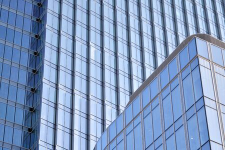 Modern office building wall made of steel and glass with blue sky Stock fotó - 133966840