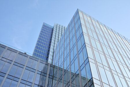 Modern office building wall made of steel and glass with blue sky Stock fotó - 133966795