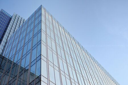 Modern office building wall made of steel and glass with blue sky Stock fotó - 133966797