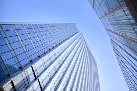 Modern office building wall made of steel and glass with blue sky Stock fotó - 133966799