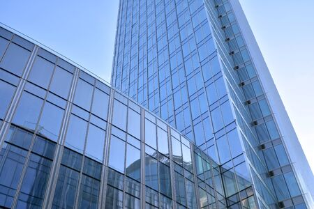 Modern office building wall made of steel and glass with blue sky Stock fotó - 133966809