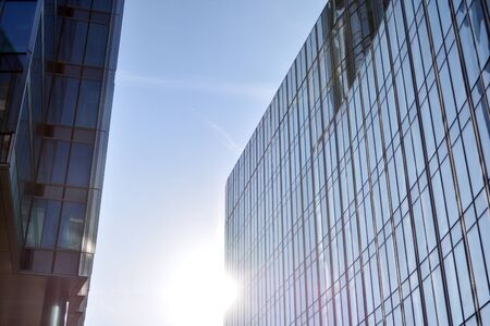 Modern office building wall made of steel and glass with blue sky Stock fotó - 133966812