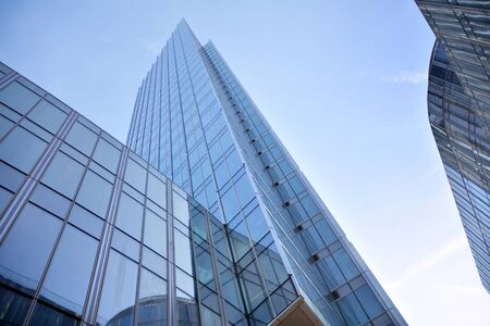 Modern office building wall made of steel and glass with blue sky Stock fotó - 133966810