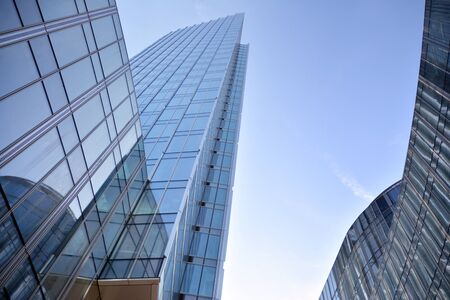 Modern office building wall made of steel and glass with blue sky Stock fotó - 133966846