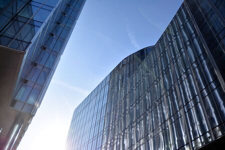 Modern office building wall made of steel and glass with blue sky Stock fotó - 133966813