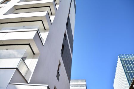 Fragment of modern residential apartment with flat buildings exterior. Detail of new luxury house and home complex.