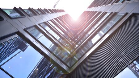 Modern office building detail, glass surface with sunlight Stock fotó