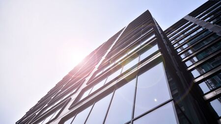 Modern office building detail, glass surface with sunlight Stock fotó - 137970990