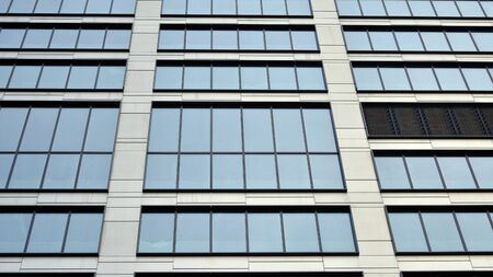 Modern office building detail, glass surface with sunlight Stock fotó - 137971364