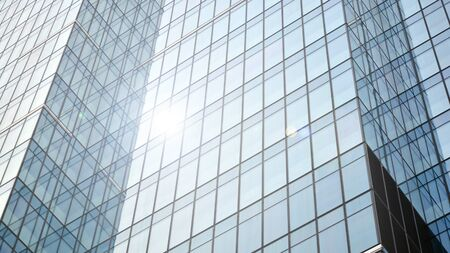 Modern office building detail, glass surface with sunlight Stock fotó - 137971235