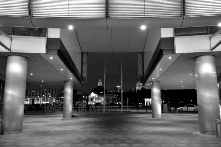 Night architecture - building with glass facade. Business district. Concept of economics, financial. Photo of commercial office building exterior. Abstract image of office building. Black and white. Stock fotó