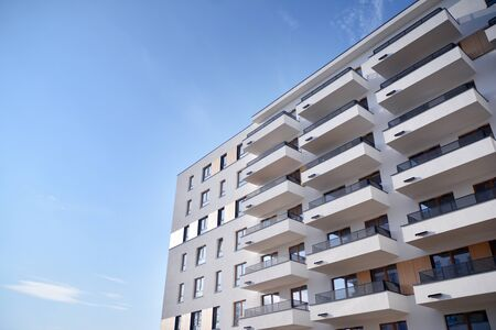 Modern and new apartment building. Multistoried, modern, new and stylish living block of flats.