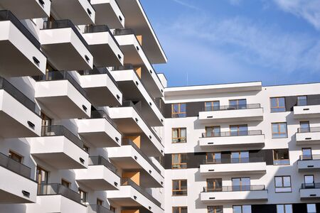 Modern and new apartment building. Multistoried, modern, new and stylish living block of flats. Stock Photo