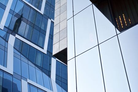 Abstract reflection of modern city glass facades. Modern office building detail, glass surface.