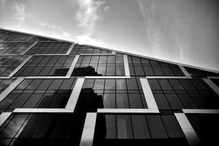 Abstract modern architecture with high contrast black and white tone. Architecture of geometry at glass window - monochrome. Stock Photo