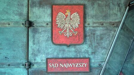 Warsaw, Poland. 7 January 2020. Coat of arms of Poland and the metal plate Sad Najwyzszy. The Supreme Court on building at Krasinski Square.
